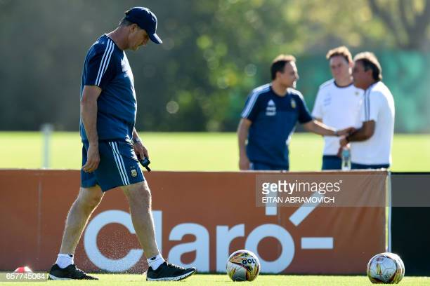 Argentina's coach Edgardo Bauza walks during a training session in Ezeiza Buenos Aires on March 25 2017 ahead of a 2018 FIFA World Cup Russia South...