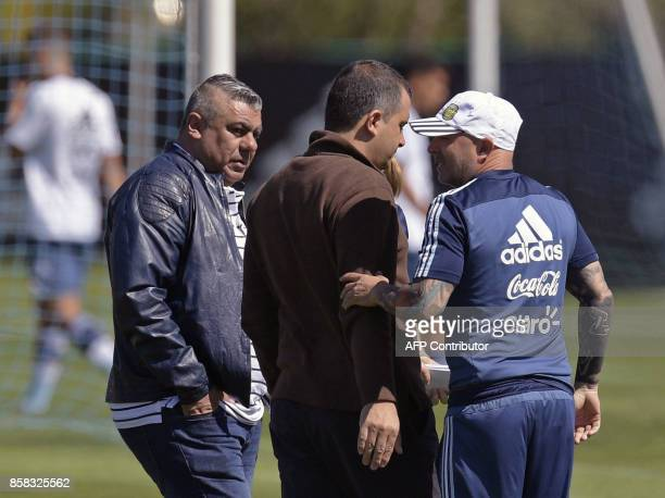 Argentina's coach Jorge Sampaoli gestures next to AFA's President Claudio Tapia during a training session in Ezeiza Buenos Aires on October 6 2017...