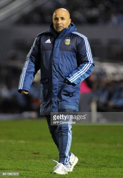 Argentina's coach Jorge Sampaoli leaves the field after the 2018 World Cup football qualifier match against Uruguay in Montevideo on August 31 2017 /...