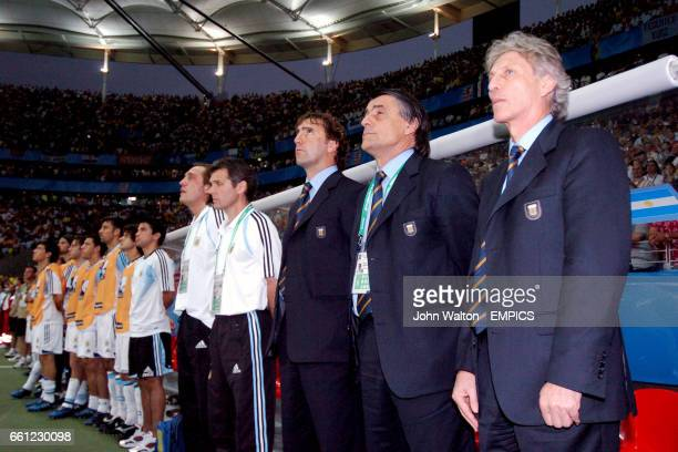 Argentina's coach Jose Pekerman and his coaching staff stand during the national anthems
