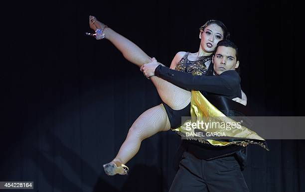 Argentina's dancer Jesus Taborda and China's Shirley Xu perform representing the city of Buenos Aires to reach the third position in the Stage Tango...