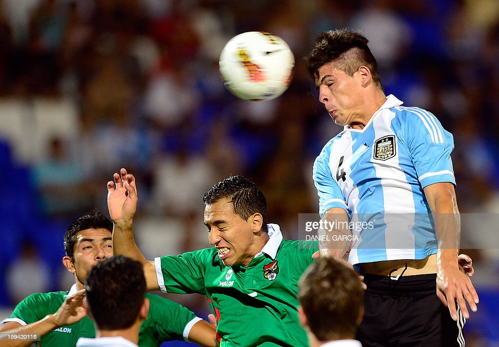 Argentina's defender Alan Aguirre (R) heads the ball in front of Bolivia's forward Carlos Paniagua during their Group A South American U-20 qualifier football match at Malvinas Argentinas stadium in Mendoza, Argentina, on January 13, 2013. Four teams will qualify for the FIFA U-20 World Cup Turkey 2013.