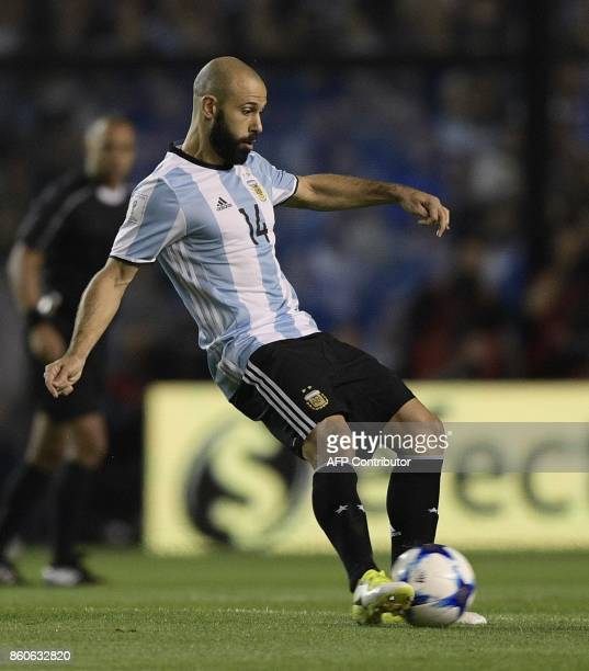 Argentina's defender Javier Mascherano kicks the ball during the 2018 FIFA World Cup South American qualifier football match against Peru at the...