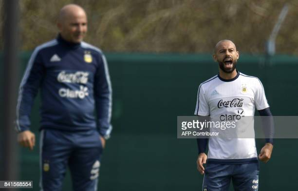 Argentina's defender Javier Mascherano shouts next to Argentina's coach Jorge Sampaoli during a training session in Ezeiza Buenos Aires on September...