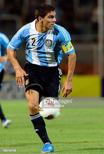 Argentina's defender Lisandro Magallan controls the ball during their football match against Chile at Malvinas Argentinas stadium in Mendoza...