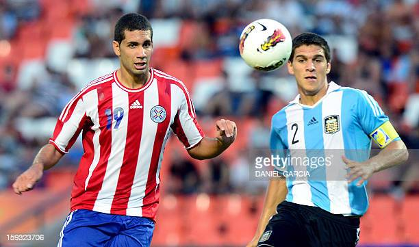 Argentina's defender Lisandro Magallan vies for the ball with Paraguay's defender Matias Perez during their South American U20 Championship Group A...