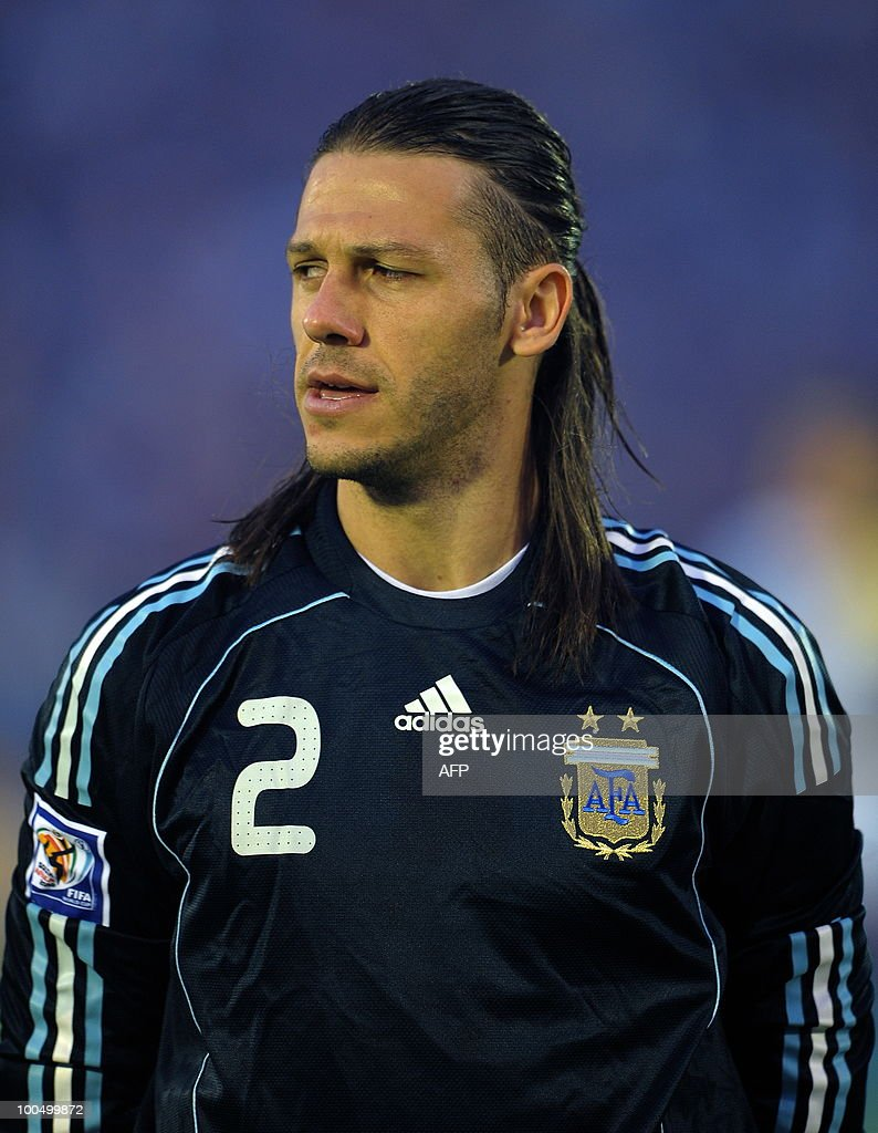 Argentina's defender Martin Demichelis sings the national anthem before the start of the FIFA World Cup South Africa-2010 qualifier football match against Uruguay at Centenario stadium in Montevideo, Uruguay on October 14, 2009. AFP PHOTO/Alejandro PAGNI