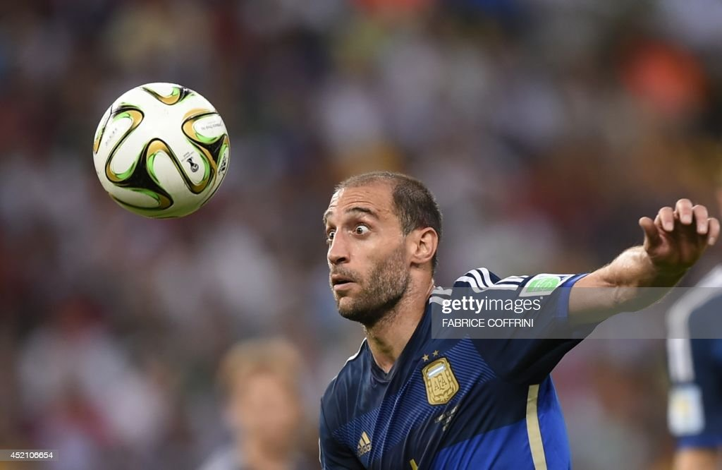 Argentina's defender Pablo Zabaleta eyes the ball during the 2014 FIFA World Cup final football match between Germany and Argentina at the Maracana Stadium in Rio de Janeiro, Brazil, on July 13, 2014.