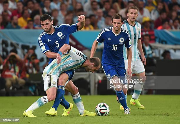 Argentina's defender Pablo Zabaleta fights for the ball with BosniaHercegovina's defender Sead Kolasinac and BosniaHercegovina's midfielder Senad...