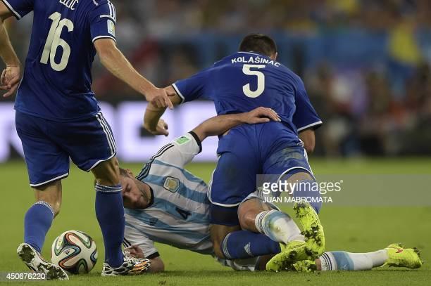Argentina's defender Pablo Zabaleta fights for the ball with BosniaHercegovina's midfielder Senad Lulic and BosniaHercegovina's defender Sead...