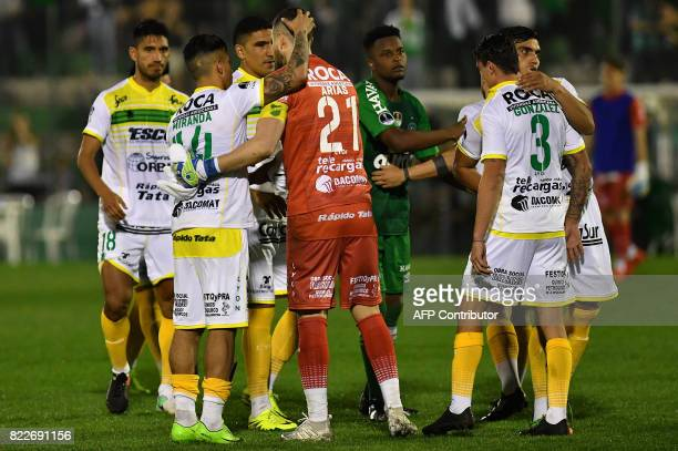Argentina's Defensa y Justicia footballers show their disappointment upon losing by penalty kicks to Brazil's Chapecoense their 2017 Copa...
