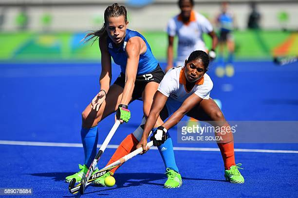 Argentina's Delfina Merino and India's Lilima Minz vie during the women's field hockey Argentina vs India match of the Rio 2016 Olympics Games at the...