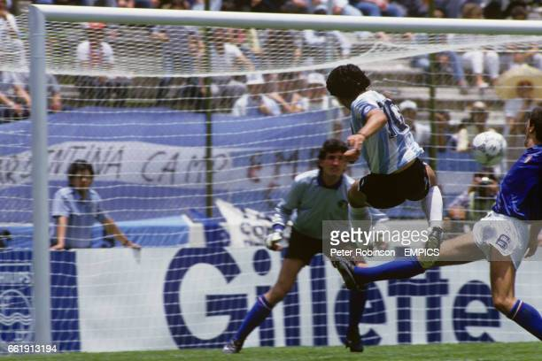 Argentina's Diego Maradona fires a shot at goal before Italy's Gaetano Scirea can intervene as Italy goalkeeper Giovanni Galli looks on
