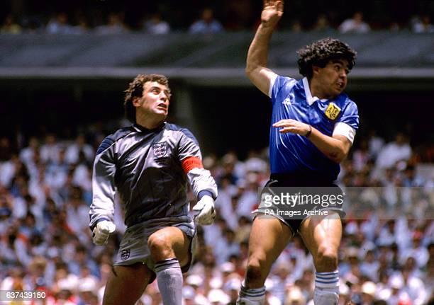 Argentina's Diego Maradona flies past England goalkeeper Peter Shilton after using his fist to score the opening goal the infamous 'Hand of God' goal