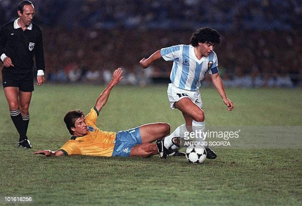 Argentina's Diego Maradona slips past 12 July 1989 Brazilian defender Dunga during first half action of their Copa America final match in Rio de...