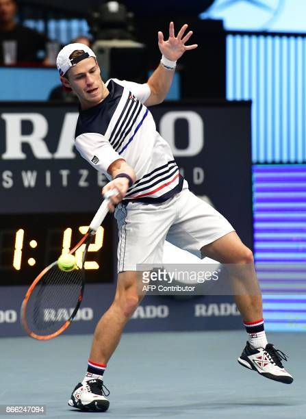 Argentina's Diego Schwartzman returns the ball to Italy's Fabio Fognini during their men's singles tennis match at the ATP tournament in Vienna...