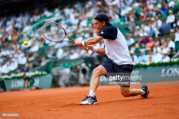 Argentina's Diego Schwartzman returns the ball to Serbia's Novak Djokovic during their tennis match at the Roland Garros 2017 French Open on June 2...