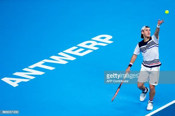 Argentina's Diego Schwartzman serves during his men's singles final tennis match against France's JoWilfried Tsonga at the ATP Antwerp tennis...