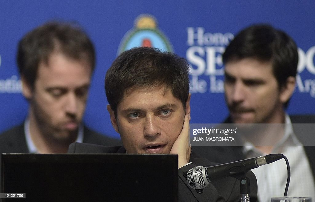 Argentina's Economy Minister Axel Kicillof gestures during his appear in the Congress about the bill to pay the debt at the Banco Nacion, Buenos Aires on August 27, 2014.