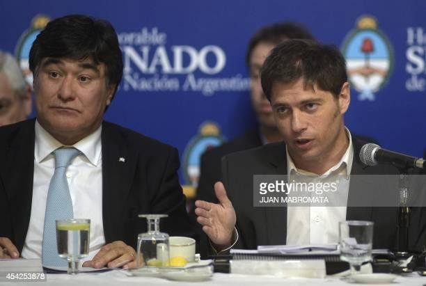 Argentina's Economy Minister Axel Kicillof talks to legislators while debating at the Congress the bill to pay the debt at the Banco Nacion...