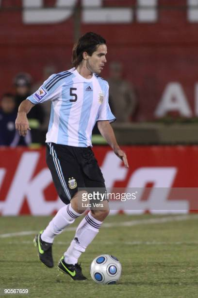 Argentina's Eduardo Gago conducts the ball against Paraguay during their 2010 FIFA World Cup qualifier at the Defensores del Chaco Stadium on...