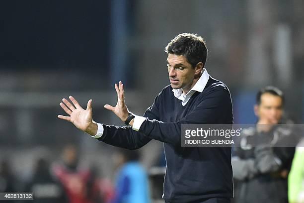 Argentina's Estudiantes de la Plata coach Mauricio Pellegrino gestures during their Copa Libertadores football match against Ecuador's Independiente...