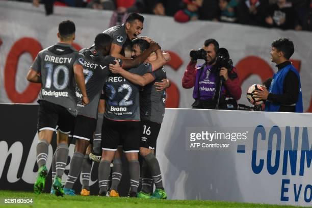 Argentina's Estudiantes de la Plata forward Mariano Pavone celebrates with teammates after scoring against Bolivia's Potosi during the Copa...