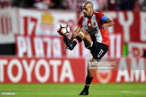 Argentina's Estudiantes de La Plata president and midfielder Juan Veron controls the ball during their Copa Libertadores football match against...