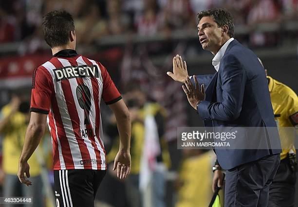 Argentina's Estudiantes de La Plata's coach Mauricio Pellegrino talks to forward Guido Carrillo during their Copa Libertadores football match against...
