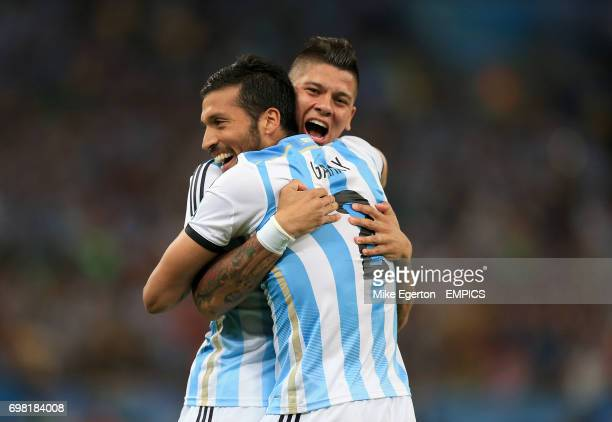 Argentina's Ezequiel Garay and Argentina's Marcos Rojo celebrate after Bosnia and Herzegovina's Sead Kolasinac scores an own goal