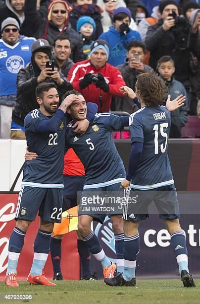 Argentina's Ezequiel Lavezzi and Lucas Orban celebrate after Federico Mancuello scored a goal during an international friendly match against El...