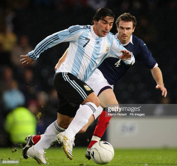 Argentina's Ezequiel Lavezzi gets past Scotland's Stephen McManus