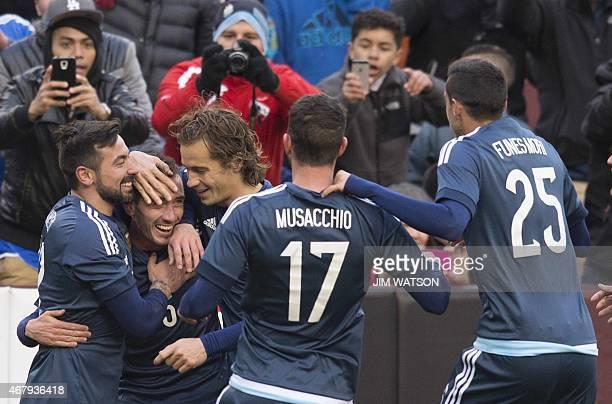 Argentina's Ezequiel Lavezzi Lucas Orban Mateo Musacchio and Ramiro FunesMori celebrate after Federico Mancuello scored a goal during an...