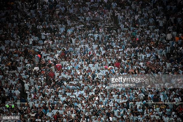 Argentina's fans cheer for their team during the Group F football match between Argentina and Bosnia Hercegovina at the Maracana Stadium in Rio De...