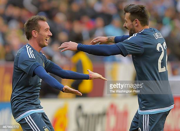 Argentina's Federico Mancuello left celebrates his late 2nd half goal with teammate Ezequiel Lavezzi during Argentina's defeat of El Salvador 2 0 in...