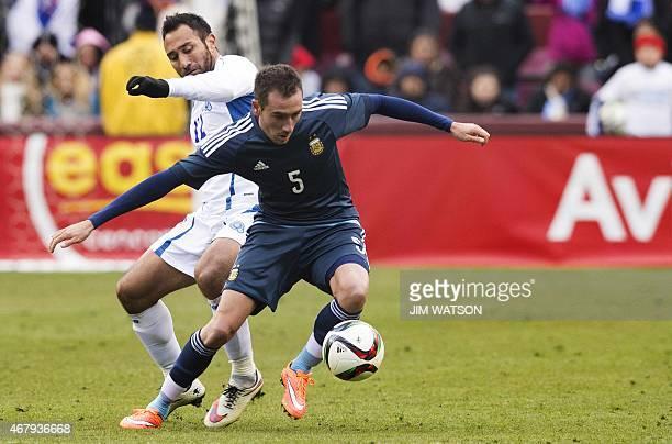 Argentina's Federico Mancuello vies for the ball against El Salvador's Arturo Alverez during an international friendly match at FEDEX Field in...