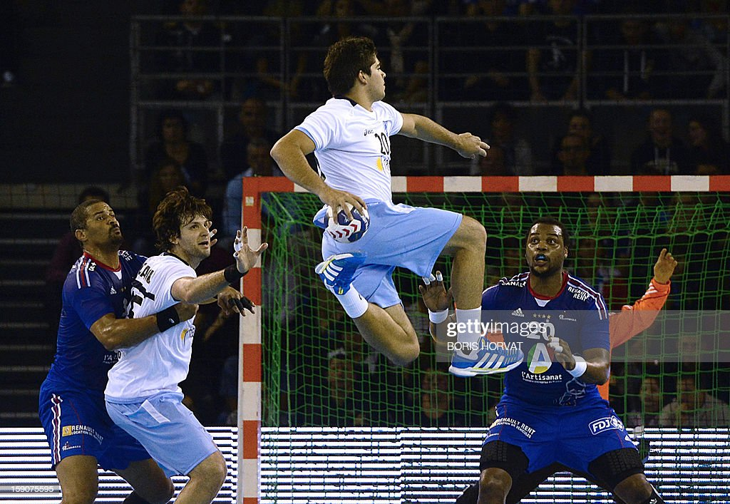 Argentina's Federico Pizarro shots to the goal during the friendly handball match France vs Argentina on January 7, 2013 in the French southern city of Toulon. AFP PHOTO / BORIS HORVAT