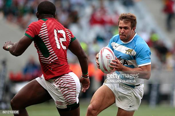 Argentina's Fernando Luna tries to pass Kenya's Willy Ambaka during the Rugby Sevens series Cape Town leg second semifinal between France and South...
