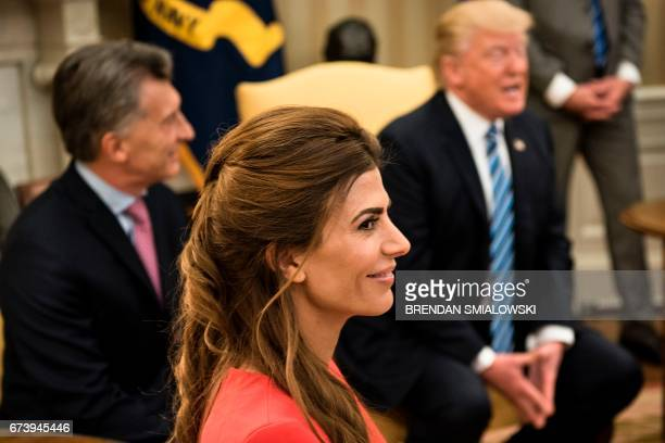 Argentina's First Lady Juliana Awada and Argentina's President Mauricio Macri listen while US President Donald Trump speaks to the press before a...