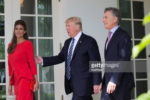 Argentina's First Lady Juliana Awada US President Donald Trump and Argentina's President Mauricio Macri of Argentina walk through the West Wing...