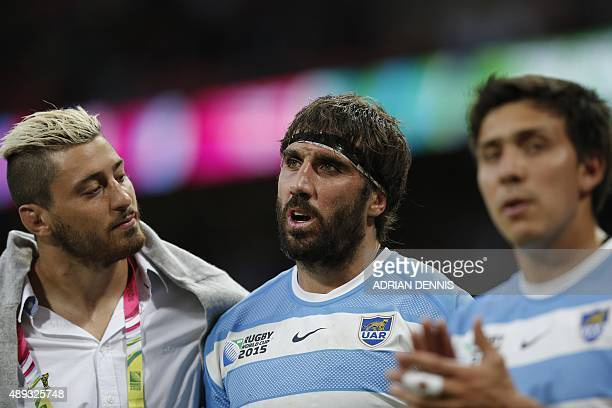 Argentina's flanker Juan Martin Fernandez Lobbe and Argentina's back row forward Javier Ortega Desio acknowledge the crowd after a Pool C match of...