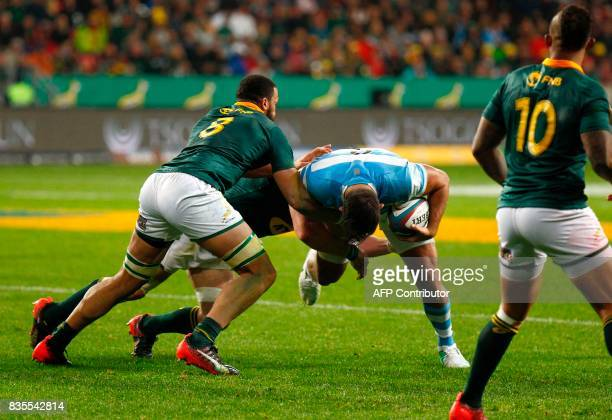 Argentina's flanker Pablo Matera is tackled during the International Rugby Championship Test match between Argentina and South Africa at The Nelson...