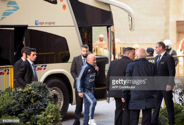 Argentina's football team coach Jorge Sampaoli arrives at a hotel in Montevideo on August 30 2017 Argentina will face Uruguay for the FIFA World Cup...