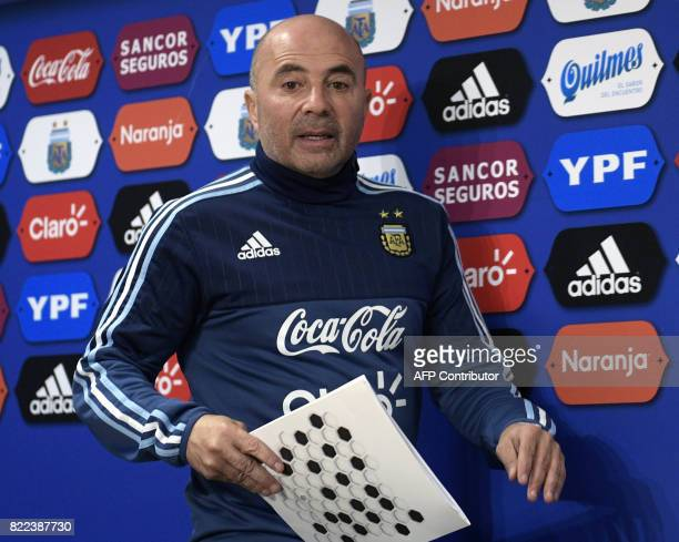 Argentina's football team coach Jorge Sampaoli arrives for a press conference in Ezeiza Buenos Aires on July 25 2017 Sampaoli will travel to Europe...