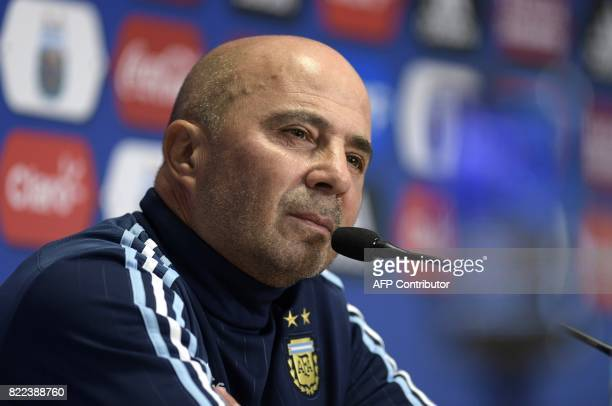 Argentina's football team coach Jorge Sampaoli gestures during a press conference in Ezeiza Buenos Aires on July 25 2017 Sampaoli will travel to...