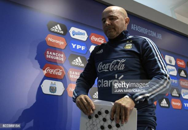 Argentina's football team coach Jorge Sampaoli leaves after a press conference in Ezeiza Buenos Aires on July 25 2017 Sampaoli will travel to Europe...