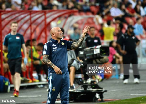 Argentina's football team coach Jorge Sampaoli reacts during the international friendly football match between Argentina and Singapore at the...