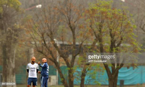 Argentina's football team coach Jorge Sampaoli speaks to defender Javier Mascherano during a training session in Ezeiza Buenos Aires on September 2...