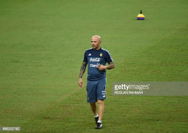 CORRECTION Argentina's football team coach Jorge Sampaoli takes part in a training session at the National Stadium in Singapore on June 12 2017...