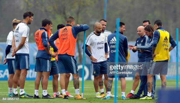 Argentina's football team coach Jorge Sampaoli talks with footballers during a training session in Ezeiza Buenos Aires on September 2 2017 ahead of a...